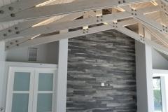 Home improvement contractors installed custom beams in ceiling