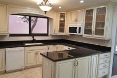 Kitchen remodel in Boynton Beach with dark countertops