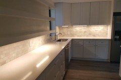 Kitchen renovation with lighting under cabinetry