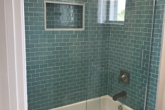 Bath remodel in Boynton Beach with green subway tiles