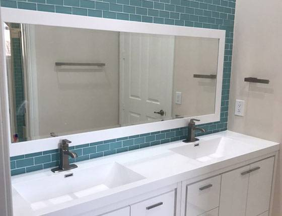 Bathroom remodel in Delray Beach blue subway tile and double sink