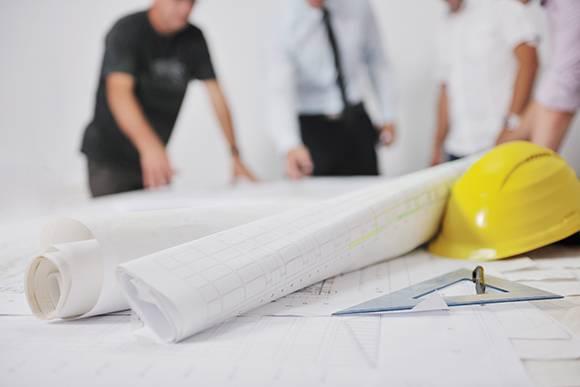 Construction Estimator in Boca Raton reviewing blueprints